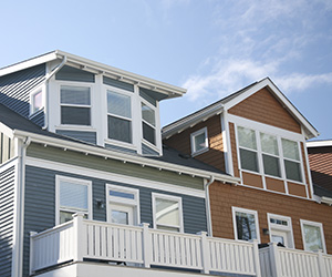 Orange and blue town homes featuring various window styles
